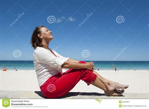 mature woman enjoying life   beach royalty  stock