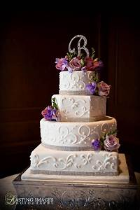 Four-tier round, square and hexagon shaped cake with ...