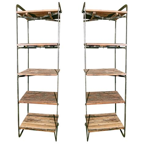 Pair Of Wrought Iron Stands With Hand Hewn Shelves At 1stdibs