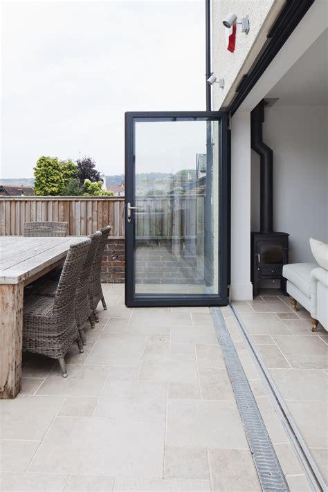 Aluminium Bifold Doors  Level Threshold With Stone Floor