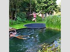Inground trampoline with a pool that looks like a pond
