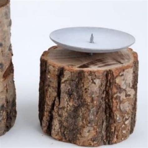 deko weihnachten holzstamm holzstamm kerzenst 228 nder naturholz mit metall kerzenteller