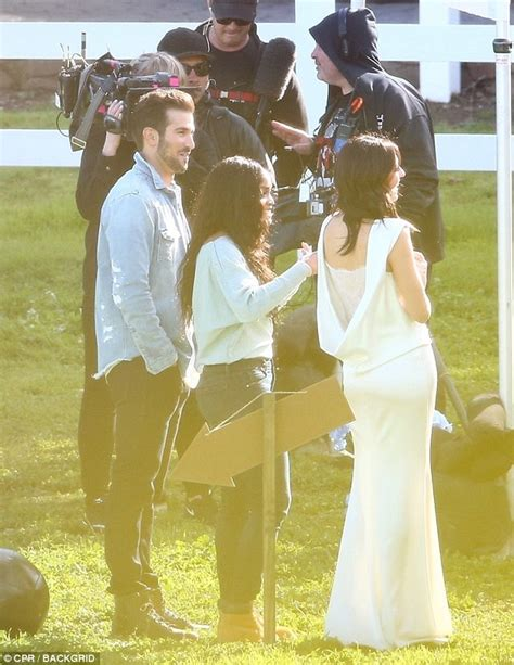 Becca Kufrin is surrounded by guys as filming begins on