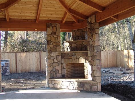 corner outdoor fireplace patio traditional with backyard