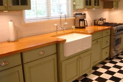 green cabinets classic black  white tiled floor