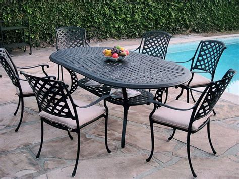 7 Piece Outdoor Patio Furniture Cast Aluminum Dining Set Ko With 6 Arm Chairs Clear Mat For Under Desk Chair Navy And White Accent Banana Leaf Dining Chairs Koala Care High Childrens Wooden Table Pillow Bed Stylish Joel Lounge
