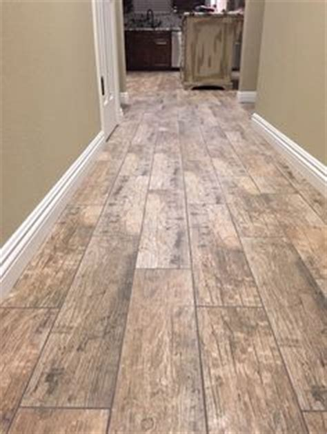 cabot porcelain tile redwood series porcelain wood look tile in upstairs bathroom home depot