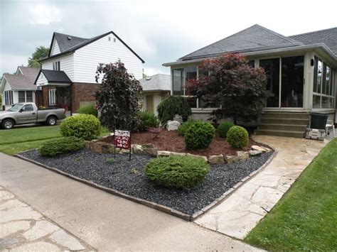 front landscaping ideas for small yards black woodchips rock design red woodchips shrubs bushes trees grassless front yard ideas