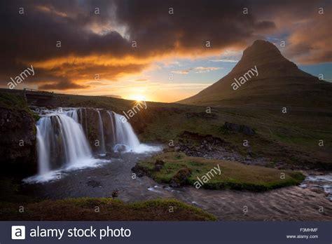 sunset kirkjufell mountain waterfall grundarfjordur stock