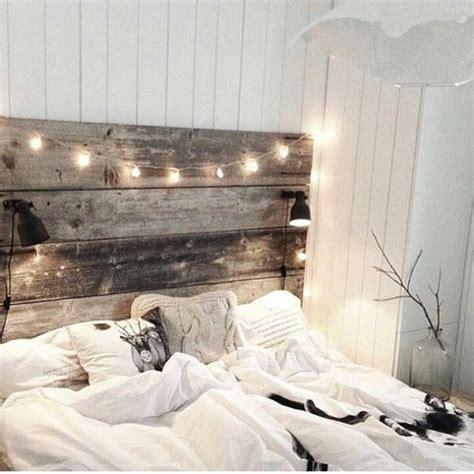 wooden headboard  reading lamps twinkle lights bedroom pinterest