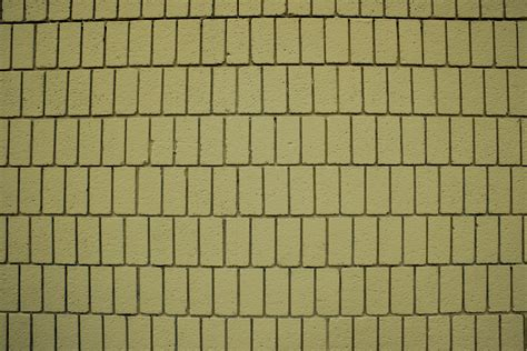 mustard yellow brick wall texture  vertical bricks