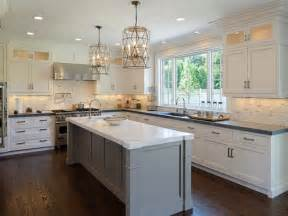 gray kitchen island faceted light pendants transitional kitchen blue water home builders
