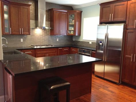 kitchen ideas with cherry cabinets cherry kitchen cabinets with gray wall and quartz
