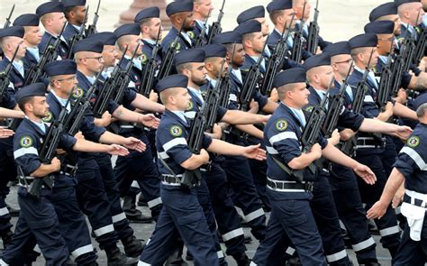 france scales  bastille day parade  concession  virus
