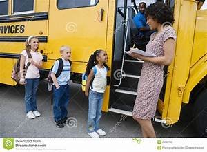Children Standing In A Line By School Bus Stock Photo ...