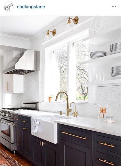 dark blue bottom cabinets  kitchen marble wall