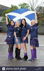 four Scottish girls in tartan kilts and saltire flag ...