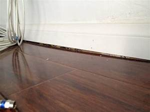 a huge gap was left between the flooring and the baseboard With gap between floor and baseboard