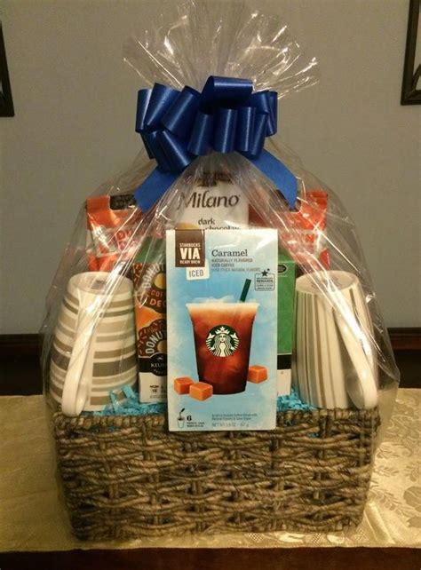 Additional gift ideas in this gift basket include a cup holder for their car and tall stirring spoons. Coffee Gift Basket, Gift basket ideas, Corporate Gifts # ...