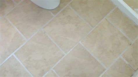 tile floor in brick pattern with tile tub sorround