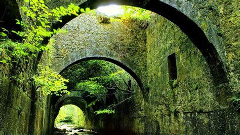 architecture building trees bridge river arch rock