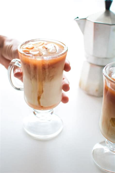 An iced caramel macchiato has only 5 ingredients: Copycat Starbucks Iced Caramel Macchiato - COOKTORIA