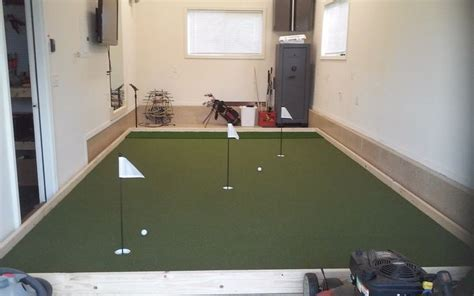 3rd car garage man cave SYNLawn golf putting green. What a