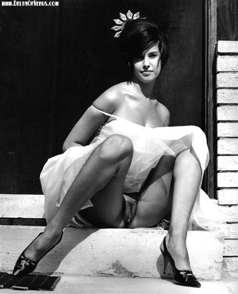 Old Black And White Of Lady Sitting On A Step Hairy