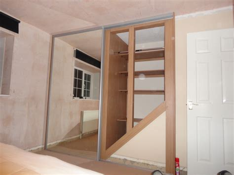 above stairs storage ideas real room designs image gallery bedrooms