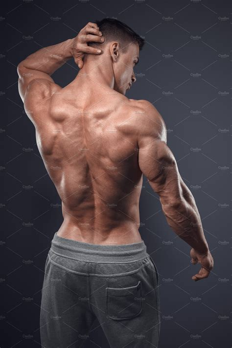 Male bodybuilder turned back | High-Quality Sports Stock Photos ~ Creative Market