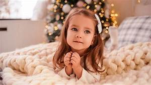 Cute, Little, Girl, Is, Lying, Down, On, Bed, In, Bokeh, Christmas