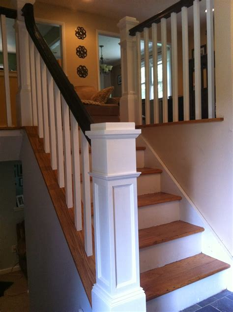 bi level home wood stairs and rails and iron balusters box newels