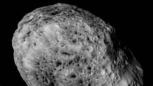 Cassini spacecraft snaps new photos of Saturn's weirdest moon