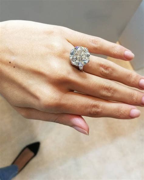Paris Hilton Is Engaged To Chris Zylka And Her Ring Is Giant. Female Rings. Coral Engagement Rings. Gothic Wedding Wedding Rings. Hexagon Wedding Rings. Black Yellow Wedding Engagement Rings. Plain Gold Rings. January 16 Wedding Rings. Sydney Rae James Engagement Rings