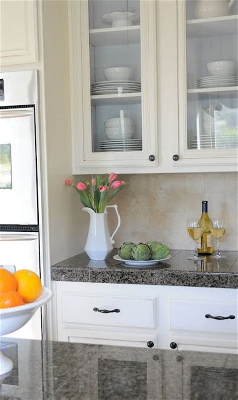 adding glass to your kitchen cabinets vintage kitchen