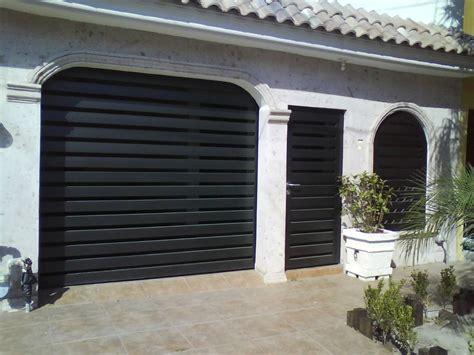fabricante de puertas ventanas protectores  portones en monterrey casas top