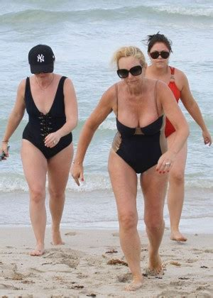 taron egerton swimsuit melissa joan hart in a swimsuit at a beach in miami gotceleb