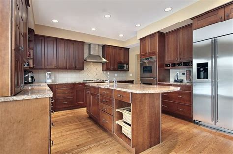 true wood cabinets u shaped kitchen with wood cabinets and middle island