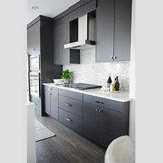 Dark Gray Flat Front Kitchen Cabinets With Gray Mosaic