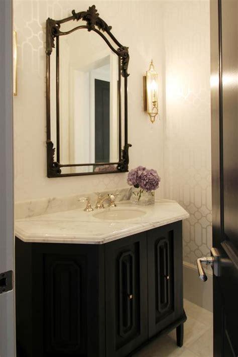 black  gold powder room  gold oval sunburst mirror