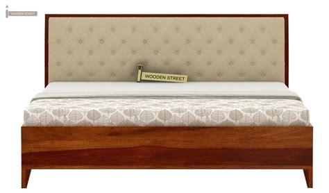 buy dorian bed  storage king size honey finish