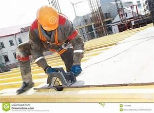 Builder Cutting Wood Board With Circular Saw Royalty Free