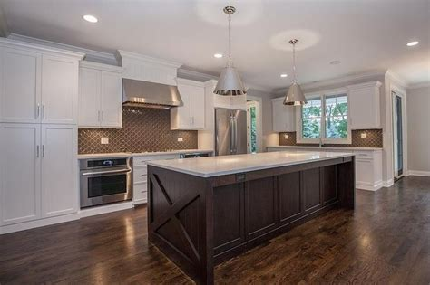 white  brown kitchen features white shaker cabinets