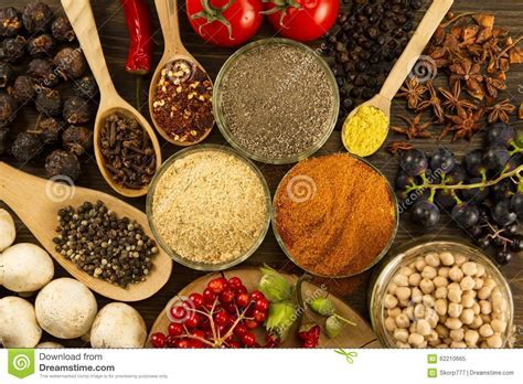 Wooden Table With Colorful Spices, Herbs And Vegetables