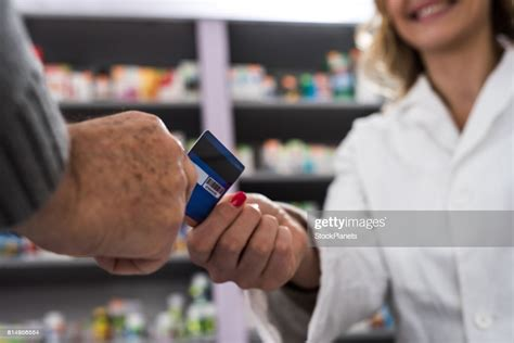 Check spelling or type a new query. Close Up Of Credit Card Payment In A Pharmacy High-Res Stock Photo - Getty Images