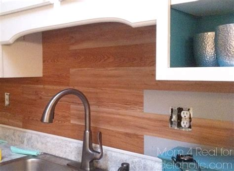 vinyl flooring used as backsplash remodelaholic diy plank backsplash using peel and stick vinyl flooring