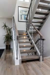 Grey Carpet Stair Treads by Grey Hardwood Floors With Open Staircase Steel Railings