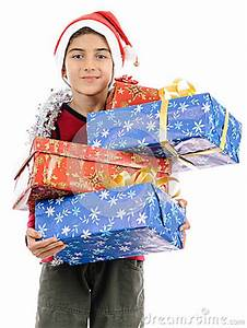Child In Santa Costume Full Present Boxes Stock