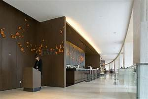 East hotel design by cl3 architects architecture for Hotel reception interior design