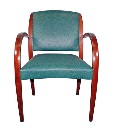 green mid century chair olde things